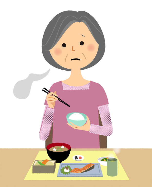 Older woman looking tired as she eats fish and rice